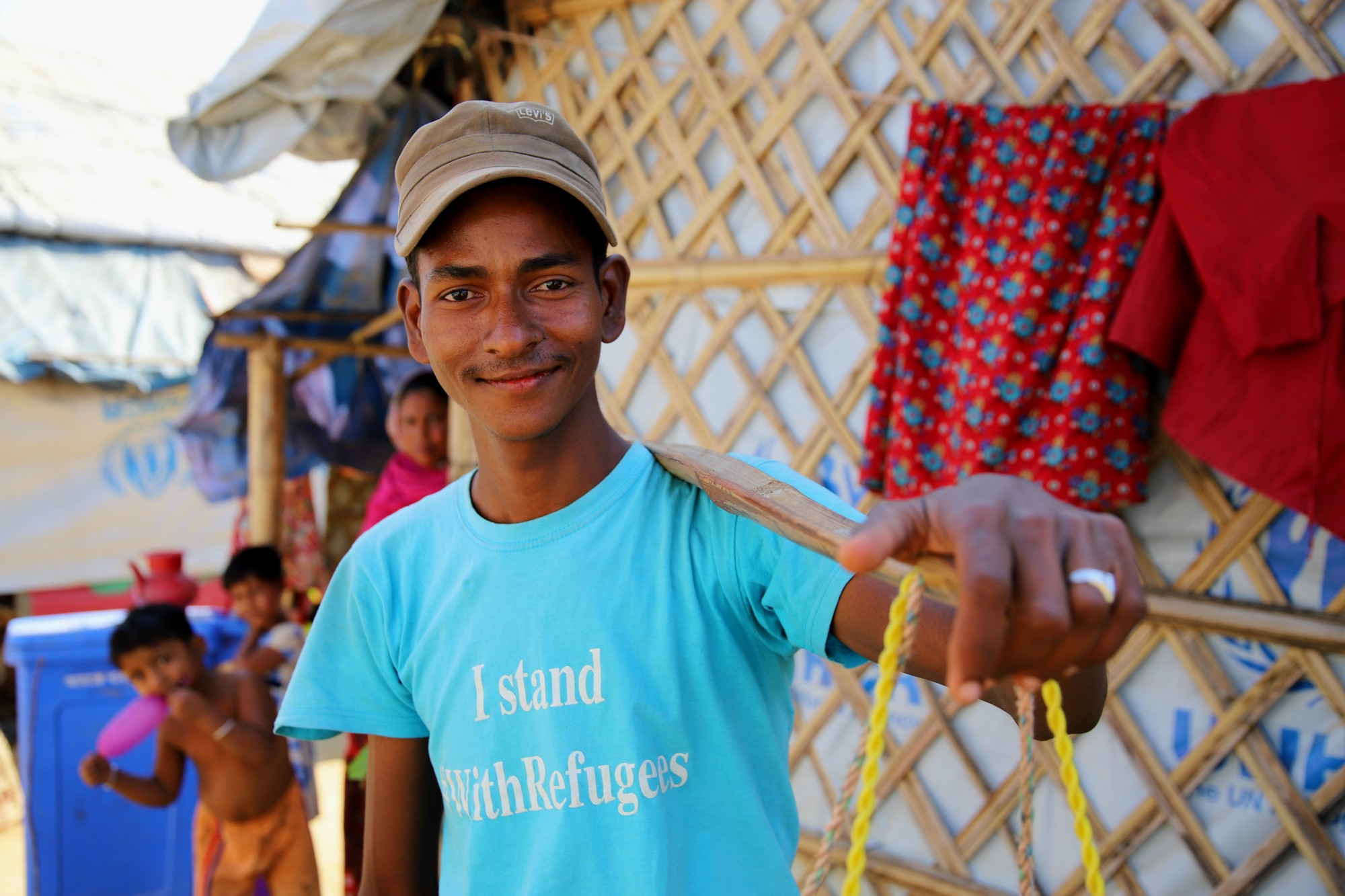 Saidul and his brother have become very popular in the camps, bringing toys and beauty products to people's homes. Photo: WFP/Gemma Snowdon