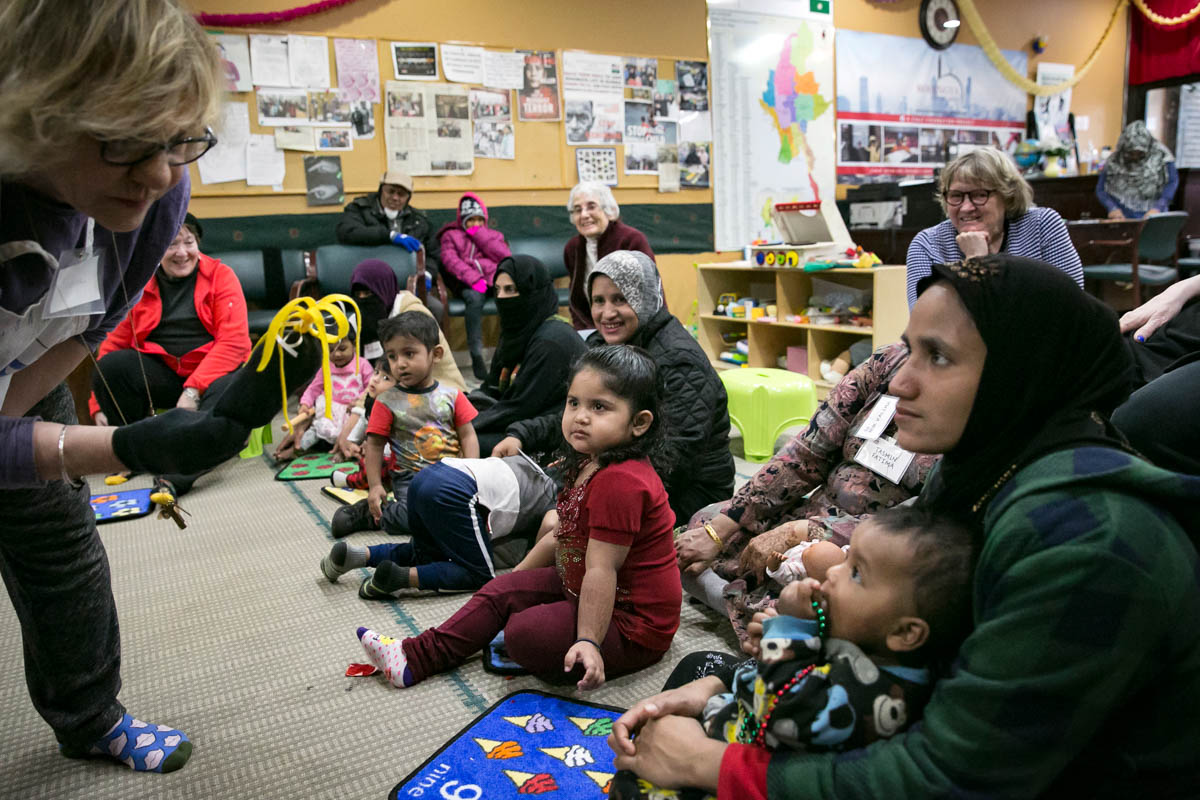 Rohingya mothers play with their children during a 'Mommy and Me' class at the Rohingya Cultural Center of Chicago. The class teaches children structured play, mothers how to bond with their children and prepare the children for school. Photo: ALLISON JOYCE/GETTY IMAGES