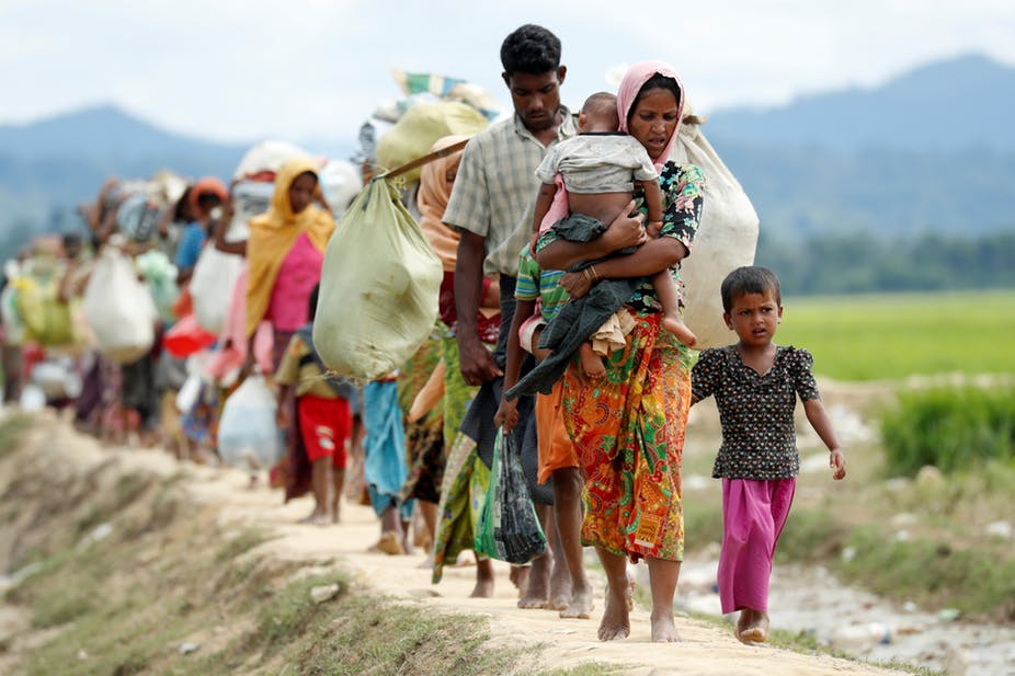 Rohingya refugees walk from Myanmar to refugee camps in Bangladesh. REUTERS/Jorge Silva