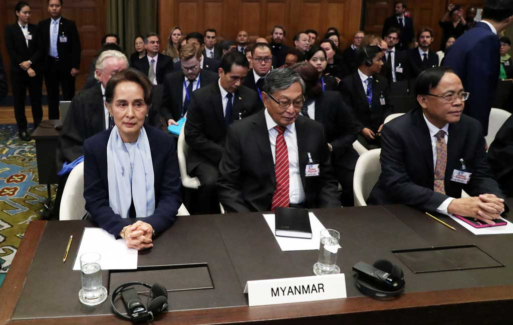 Myanmar's leader Aung San Suu Kyi attends a hearing on the second day of hearings in a case filed by Gambia against Myanmar alleging genocide against the minority Muslim Rohingya population, at the International Court of Justice (ICJ) in The Hague, Netherlands December 11, 2019 Reuters