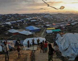 Rohingya refugee children fly improvised kites at the Kutupalong refugee camp near Cox's Bazar, Bangladesh. Credit: Damir Sagolj/Reuters
