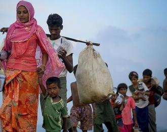 Rohingya fleeing to Bangladesh