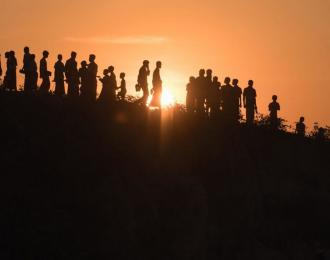 Rohingya refugees walk down a hillside at the Kutupalong refugee camp in Cox's Bazar on November 27, 2017. PHOTO: AFP