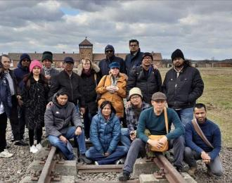 Human rights defenders and genocide scholar-activists from four continents on a study tour of Auschwitz-Birkenau, Poland, 12 March 2020.